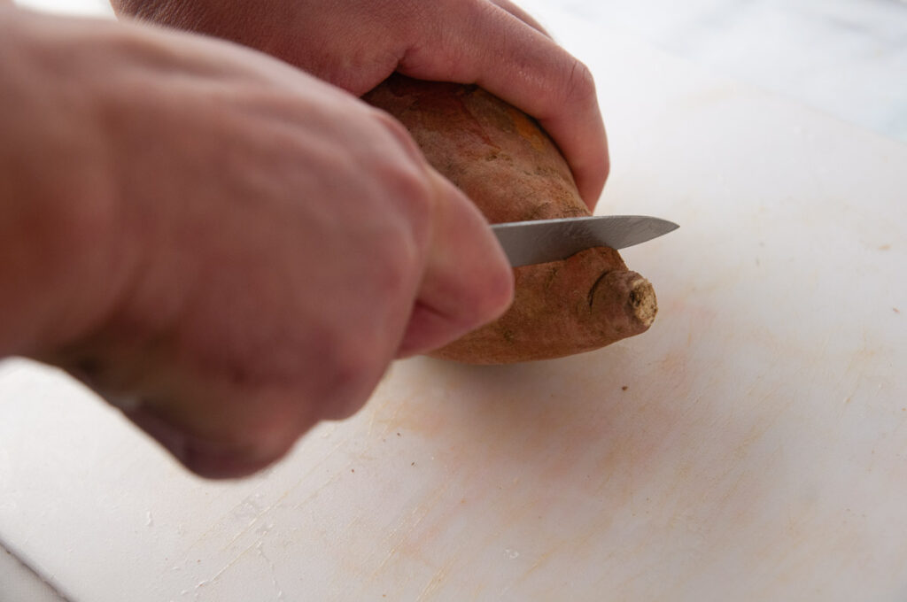 Cut the pointed ends off of the sweet potato.