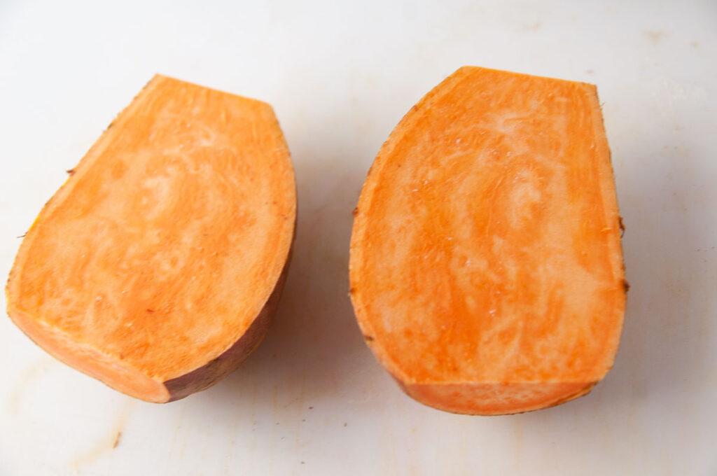 Now cut the potato in half.