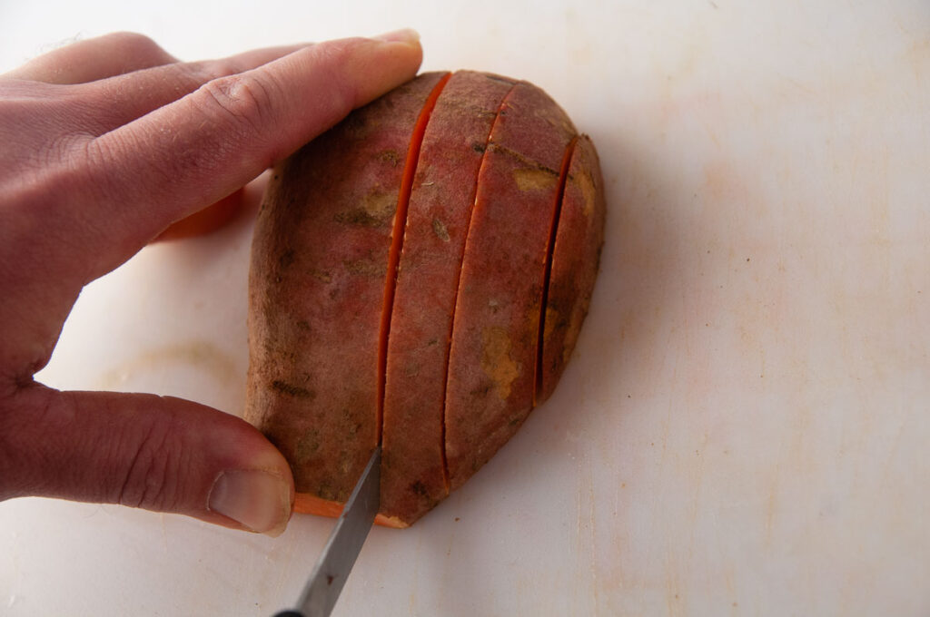 Make roughly 1/4 inch to 1/2 thick slices in the sweet potato.