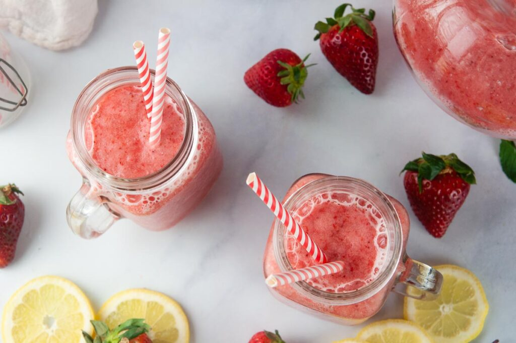 Frozen Strawberry Lemonade is the perfect slushie to cool down with this summer.