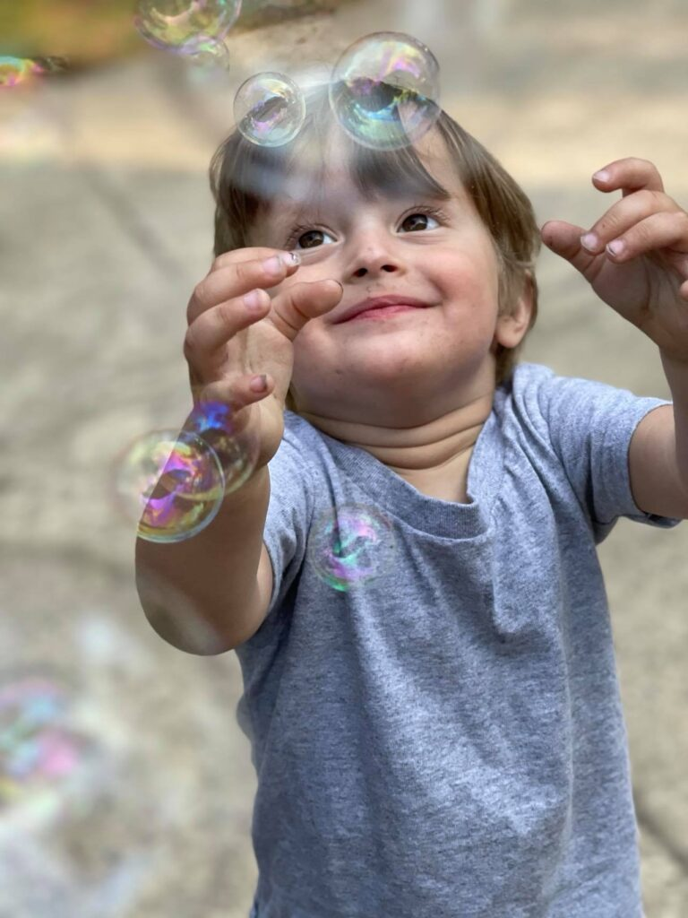 toddler boy with bubbles