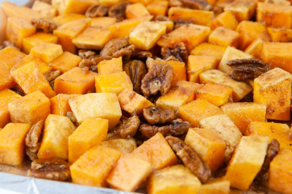 A tray of cinnamon sugar button squash ready to get roasted